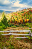Colorful autumn landscape scene with fence in Transylvania Stock Photo