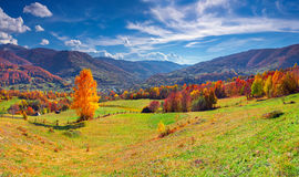 Colorful autumn panorama of mountain village Stock Photos