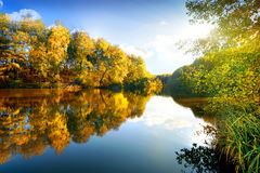 Colorful autumn on river Royalty Free Stock Photo