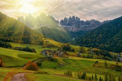 Colorful autumn scenery in Santa Maddalena village at sunrise. Dolomite Alps, South Tyrol, Italy. Colorful autumn scenery in Santa Maddalena village with church royalty free stock photography