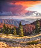 Colorful autumn sunrise in the Carpathian mountains. Royalty Free Stock Image