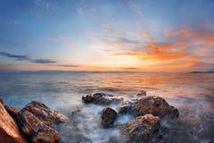 Colorful autumn sunrise on rock beach. Dramatic morning scene of the Ionian Sea, Corfu island location, Greece, Europe. Beauty of nature concept background Stock Image
