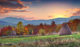 Colorful autumn sunset in mountain village Stock Images