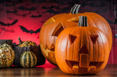 Colorful autumn theme with halloween scary pumpkins Stock Images