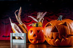 Colorful autumn theme with halloween scary pumpkins Royalty Free Stock Photo