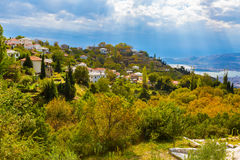 Colorful autumn trees and mountain village aerial view Stock Photo
