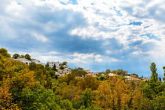 Colorful autumn trees and mountain village aerial view Stock Photos