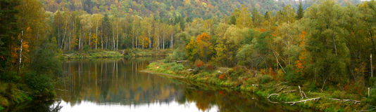 Colorful autumn valley with river Royalty Free Stock Image