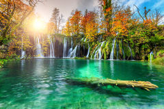 Colorful aututmn landscape with waterfalls in Plitvice National Park, Croatia. Stunning colorful autumn landscape with spectacular lake and waterfalls in Royalty Free Stock Photos