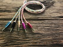 Colorful auxiliary lines on old wood floor with the concept of technology, cable, mobile peripherals, entertainment, modernity, ad Stock Images