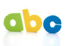Colorful a b c foam letters Stock Photos