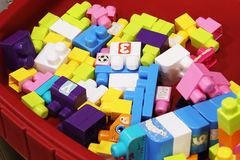 Colorful baby building blocks in a wagon stock image