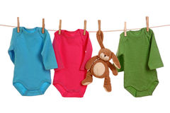 Colorful baby goods. Hanging on the clothesline Stock Images