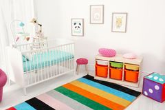 Colorful baby room interior with crib. Colorful baby room interior with comfortable crib Stock Photography