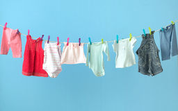 Colorful baby's clothes getting dry Royalty Free Stock Photography