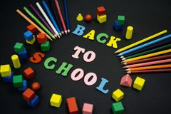 Colorful Back to School. Text title on black background Stock Photos