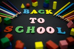 Colorful Back to School. Selective focus of colorful Back to School text title on black background Stock Image