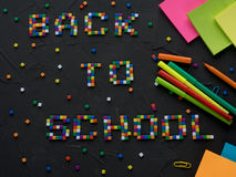 Colorful BACK TO SCHOOL words with part of color pencil tips shown in the frame. Concept of back to school Stock Image
