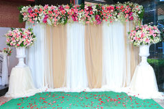 Colorful backdrop flowers with white and gold fabric arrangement Stock Photos