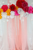Colorful backdrop paper flower with fabric arrangement Royalty Free Stock Photo