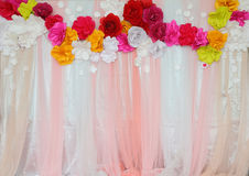 Colorful backdrop paper flower with fabric arrangement Stock Photos