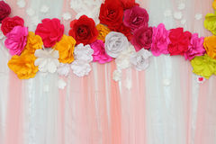 Colorful backdrop paper flower with fabric arrangement Royalty Free Stock Photography