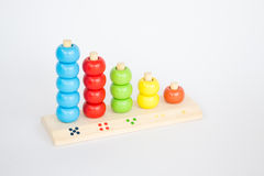 Colorful backgammon wooden toy on white table Stock Image