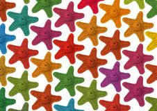Colorful background. It is the beautiful multi-coloured background consisting of knot starfishes Stock Photo