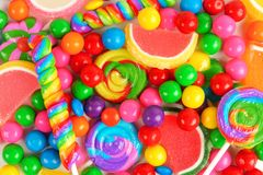 Colorful background of assorted candies. Including gum balls, lollipops and jelly candies Royalty Free Stock Images