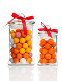 Colorful background of assorted Gumballs in glass jar. Over white background stock photos