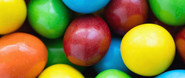 Colorful background of assorted rainbow Choco coated  peanut. Letterbox format Royalty Free Stock Images