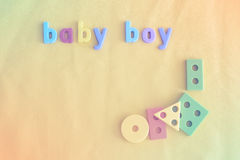 Colorful background for baby boy with letters. Copy space. Stock Image