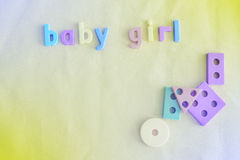 Colorful background for baby girl with letters. Image with color filters. Royalty Free Stock Image