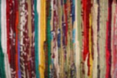 Colorful Background. Defocused background of varius colorful fabric stripes stock photo