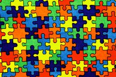 Background of a fabric with pieces of puzzle Royalty Free Stock Image