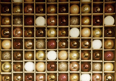 Colorful Background Grid Pattern of Vintage Glass Holiday Decora. Box of vintage colorful holiday decorative glass balls creates a background grid pattern in a Royalty Free Stock Photography
