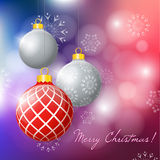 Colorful Background with hanging Christmas balls and snowflakes. Royalty Free Stock Photography