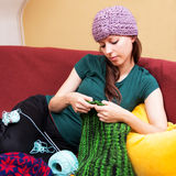 Colorful background with knitting woman Stock Image