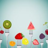 Colorful Background made of fruits on the forks Stock Images