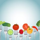 Colorful Background made of vegetables on the forks Stock Images