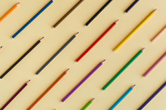Colorful background with many crayons pastels lined up on yellow Stock Images