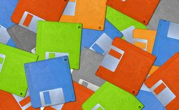 Colorful background with old floppy disks - diskette stock photos