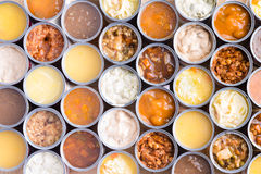 Colorful background of opened cans of soup Royalty Free Stock Image