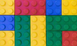 Colorful background of plastic block toy in random pattern Stock Photos
