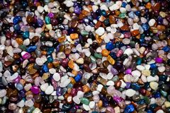 Colorful background with small stones. Abstract background with colored rocks. Shiny precious small stones background. Closeup ima royalty free stock image