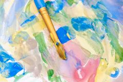 Colorful background of splashes of color and a brush royalty free stock photo