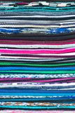 Colorful background striped pattern of overlocked binding on carpets or textile in the colours of the rainbow showing. The texture of the stitching Royalty Free Stock Photo