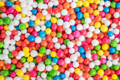 Colorful background texture with sugar candy sprinkles dot Royalty Free Stock Images