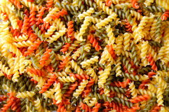 Colorful background texture uncooked pasta Stock Photos