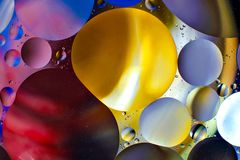 Colorful background from water drops. And oil Stock Image